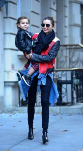 Miranda Kerr and son Flynn Bloom head out of their New York City apartment for JFK airport