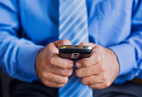 getty_rf_photo_of_man_texting_on_phone